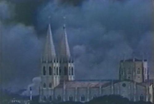 Nasusunog na ang timog na bahagi ng Maynila,  Ang San Sebastian Church mula sa tore ng Sto. Tomas.  Mula sa War Crimes in Manila ni David Griffin.