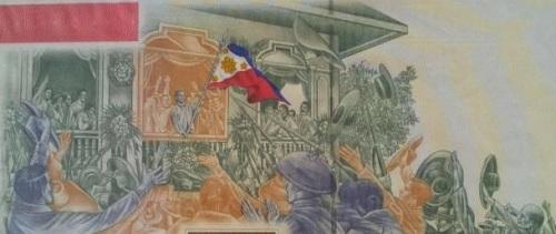 Ang proklamasyon ng Kasarinlan ng Pilipinas noong June 12, 1898.  Mula sa 100,000 pisong perang papel na inilabas ng Bangko Sentral para sa Sentenaryo ng Kasarinlan noong 1998.