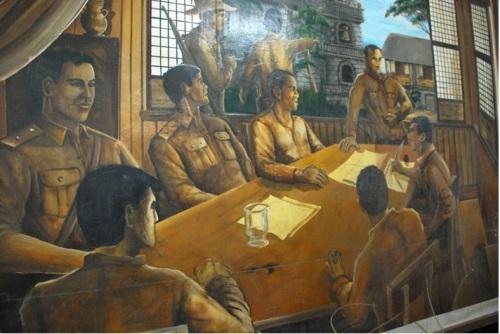 Ang pulong nina Supremo Bonifacio para sa Naic Military Agreement sa ikalawang palapag ng Casa Hacienda de Naic.  Nakasabit sa function room ng paaralan.