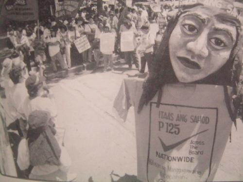 Ang walang hanggang paghingi ng pagtaas sa sahod ng mangagawa noong Araw ng Paggawa 2003.  Mula sa Filway's Philippine Almanac 2012.