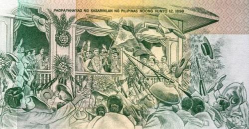 Ang proklamasyon ng Kasarinlan ng Pilipinas noong June 12, 1898. sa dating limang pisong perang papel.  Obra maestra ni Eufronio Cruz.  Mula sa Bangko Sentral ng Pilipinas.