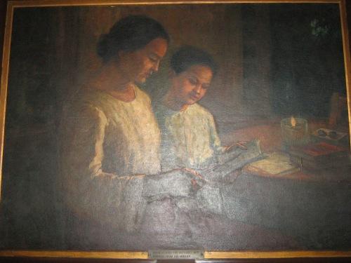 Si Rizal habang tinuturuan ng kanyang ina.  Mula sa Dambanang Rizal a Calamba, Laguna.
