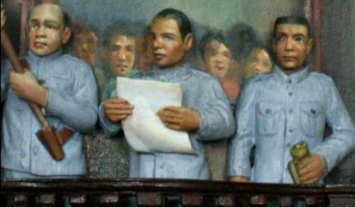 Pagwagayway ni Ambrosio Rianzares Bautista ng watawat.  Mula sa Ayala Museum The Diorama Experience.