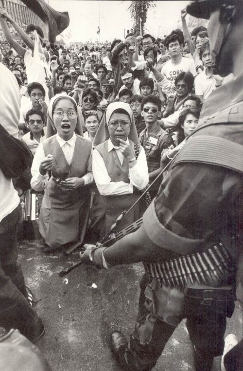 Iconic Pete Reyes photograph which captured the highlight of the 1986 People Power Revolution, when the Pro-Marcos Marine tanks under Gen. Artemio Tadiar were peacefully stopped by the people from attacking the rebel forces at Ortigas Ave. cor EDSA.