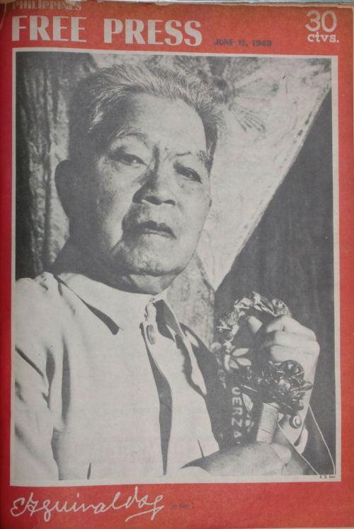 Pabalat ng Philippine Free Press na nagpapakita sa matandang heneral hawak ang Espada ni Aguirre na nakuha niya sa Labanan sa Imus noong 1898, at ang bandilang Aguinaldo-Suntay sa kanyang tabi.
