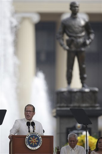 President Benigno Simeon Aquino, III hails Andres Bonifacio and uses the Guilermo Tolentin-made  monument at the Liwasang Bonifacio as the illustration of the Filipino, calm but determined in the face of threats against our sovereignty in his 115th Independence Day speech, 12 June 2013 (AP Photo/Aaron Favila).