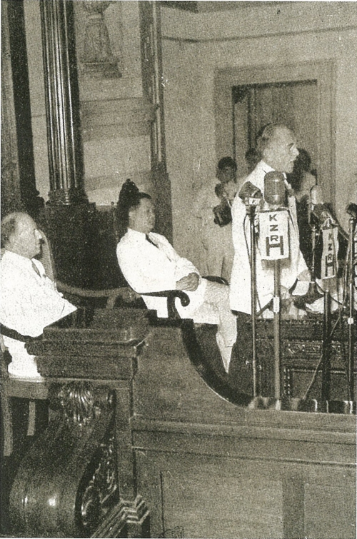 Fom gov.ph:  President Manuel L. Quezon delivers his 1940 message to the National Assembly in front of its Speaker Jose Yulo and United States High Commissioner Francis B. Sayre.